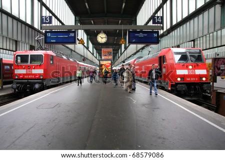 STUTTGART - JULY 24: Deutsche Bahn Regio trains on July 24, 2010 in Stuttgart, Germany. DB took over Arriva Plc company in August 2010. - stock photo