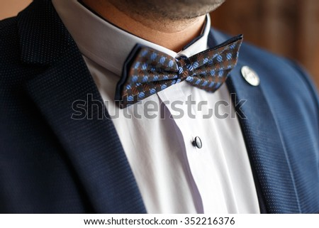 style groom butterfly accessory