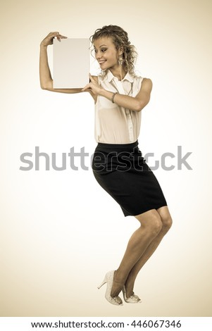 Styled portrait of business woman hold empty blank board - stock photo