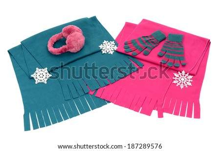 Styling a scarf with different accessories. Pink and blue winter scarves with fringe, gloves and earmuffs isolated on white background. - stock photo