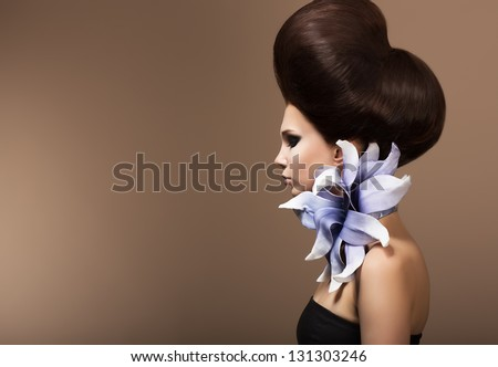 Styling. Gorgeous Fashion Woman with Trendy Hairstyle. Brown Hairs - stock photo
