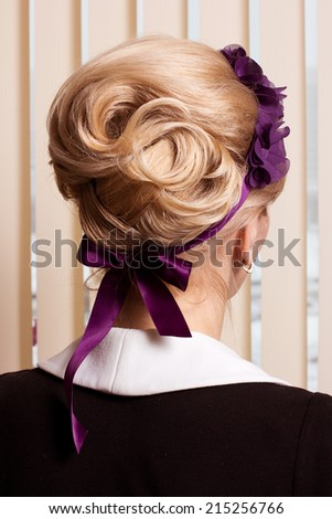 Styling. Rear View of Frizzy blond Hair Woman. Haircare Spa Salon Concept - stock photo