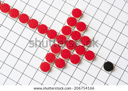 Stylised graphic of a thrust against a small and weak opponent, created using counters from a game of 'Go'.