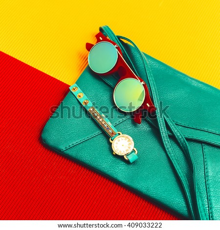 Stylish Accessories. Green Leather Clutch, Watches and Sunglasses. Be fashion Lady - stock photo