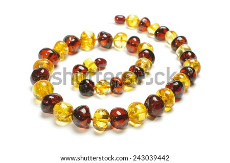 Stylish amber necklace with clipping path - stock photo