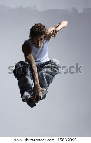 stylish and cool breakdance style dancer posing - stock photo