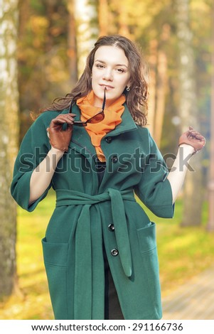 Stylish and Fashionable Caucasian Brunette Female Model with Sunglasses Outdoors.Vertical Image Composition - stock photo