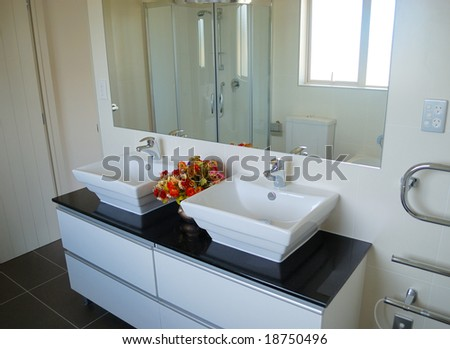 stylish bathroom interior with mirror and decoration - stock photo