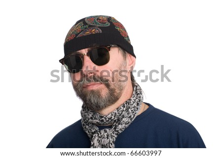 Stylish bearded middle aged man in a hattock.