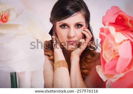 stylish beautiful and tender girl in the photo shoot flowers - stock photo