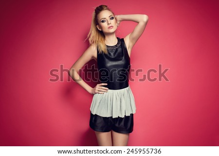Stylish beautiful blonde woman wearing leather clothes. Fashion picture  - stock photo