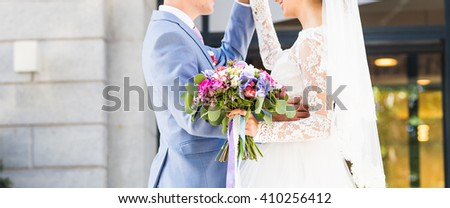 Stylish beautiful happy bride and groom, wedding celebrations outdoors