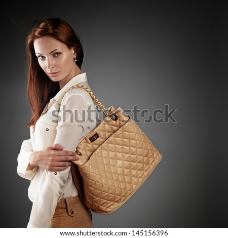 Stylish beautiful woman on dark grey background - stock photo