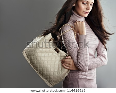 Stylish beautiful woman on grey background - stock photo