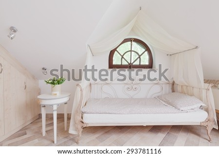 Stylish bed with canopy in romantic bedroom - stock photo