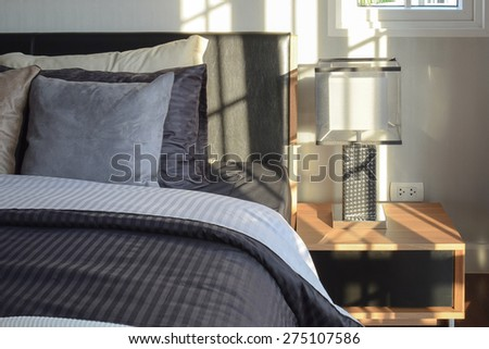 stylish bedroom interior decorative with modern bedside table lamp - stock photo