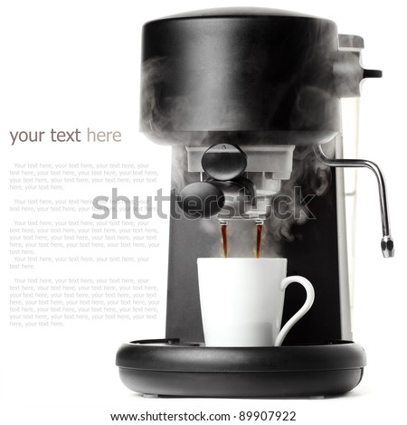 Stylish black coffee machine with a white cup - stock photo