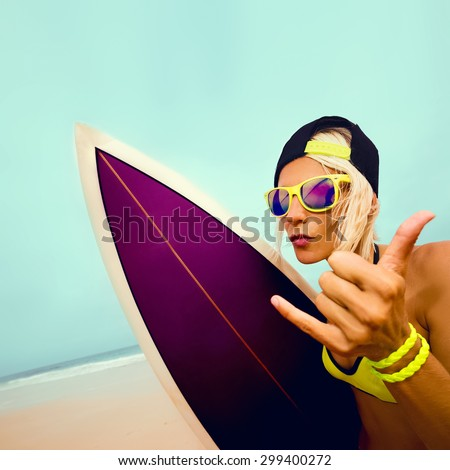 Stylish Blond on the Beach with bright Surf board. Surfing time - stock photo