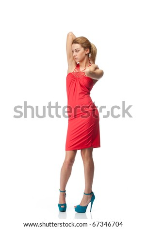 Stylish blonde fashion model posing in red dress