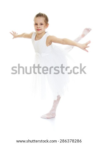 Stylish blonde girl in a white ballet dress makes swallow-Isolated on white background