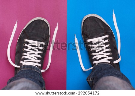 stylish blue gym shoes with white laces on a color background - stock photo