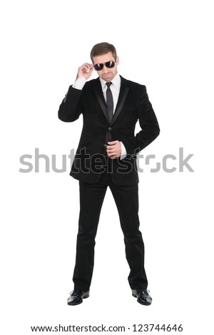Stylish bodyguard with glasses and folded arms. Isolated over white background - stock photo