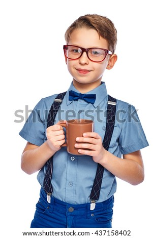 Stylish boy in glasses holding cup of tea, coffee or juice. Looking into the camera. Isolated on a white background. - stock photo