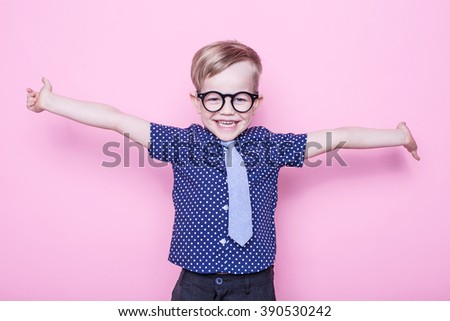 Stylish boy in shirt and glasses with big smile. School. Preschool. Fashion. Studio portrait over pink background - stock photo