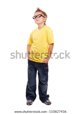 Stylish boy in yellow tshirt over white background full length - stock photo
