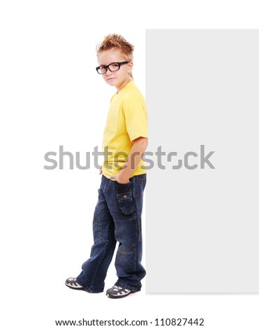 Stylish boy leaning to blank board