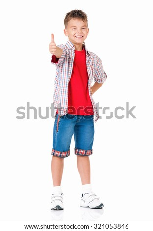 Stylish boy over white background full length showing thumbs up