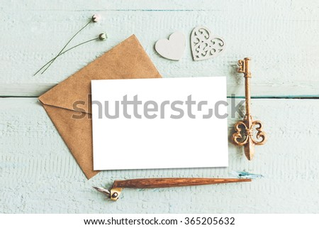 Stylish branding mockup to display your artworks. Cute vintage mock up on wooden background. - stock photo