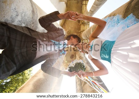 stylish bride and groom outdoors kissing moment - stock photo