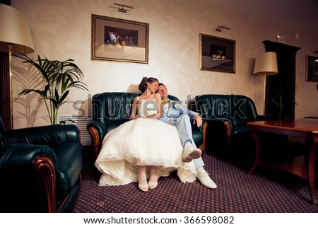 stylish bride in white dress and groom in a blue suit