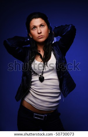 stylish brunette against neon glowing background