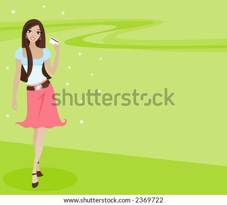 Stylish brunette with her credit card in hand - stock photo