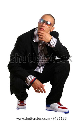 Stylish Business Young man in stylish business fashion with sunglasses on - over white background. - stock photo