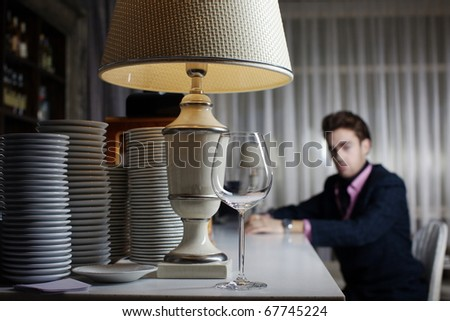 Stylish businessman at the restaurant for a business lunch