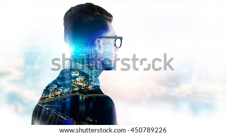 Stylish businessman in glasses on illuminated night Singapore city background with copy space. Double exposure - stock photo