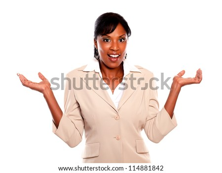 Stylish businesswoman looking at you with arms up on isolated background - stock photo
