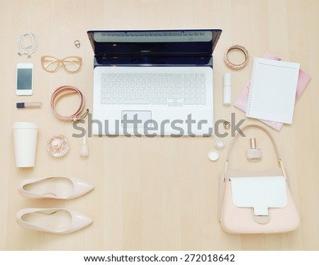stylish casual set of computer and stuff for urban woman in soft colors, fashion concept  - stock photo