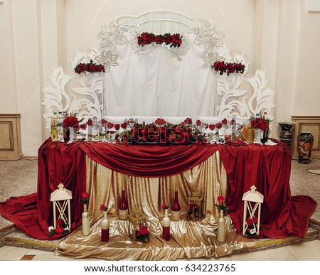Stylish Centerpiece Table For Bride And Groom With Red Golden Decor, Luxury  Decorated Place For