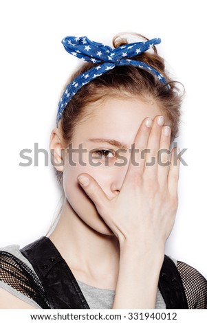 Stylish cute teen girl covered her face with her hand on white background not isolated