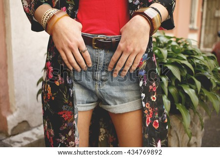 Stylish denim shorts. Details. Youth summer fashion, boho, bohemian, hippy vibes. Photo toned style instagram filters