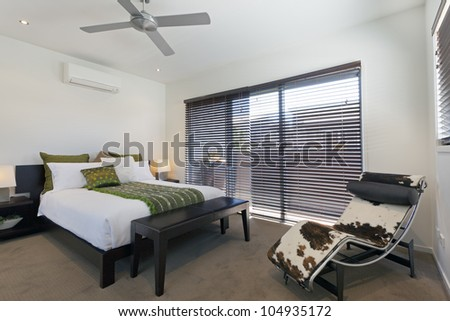 Stylish double bedroom in Australian mansion - stock photo