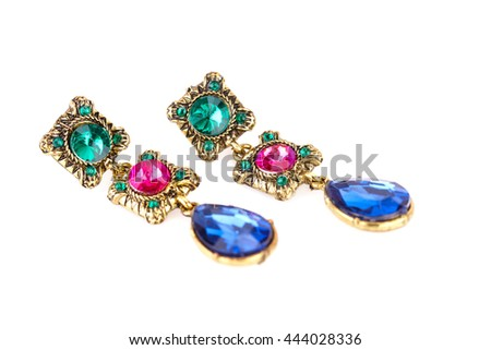 Stylish earrings with colorful stones isolated on white background.