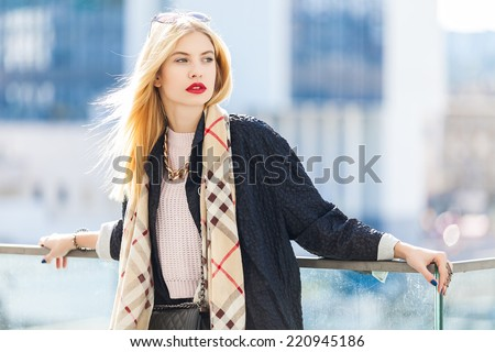 Stylish fashion portrait of blonde woman. Posing in the city - stock photo