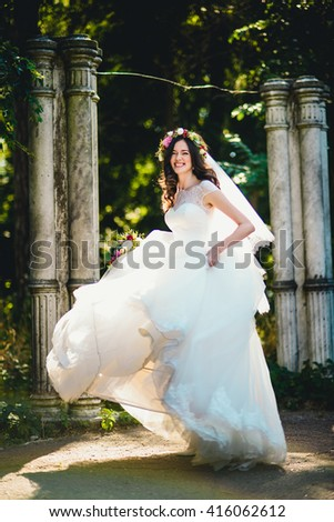 stylish funny woman in white dress dancing in the street - stock photo