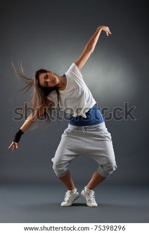 stylish girl dancing modern ballet dance , with a headbanging move