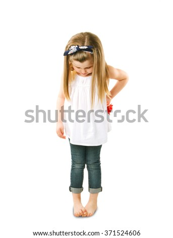 stylish girl embarrassed her head and crossed her legs - stock photo